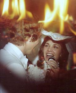 This is a photo of me singing to my husband at our wedding reception in 1979.